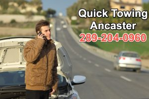 man calling for assistance on side of road in Ancaster